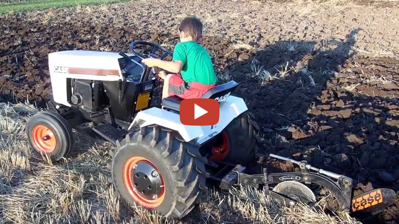 Case Garden Tractor Plow : Case  garden tractor plowing tire spinning action