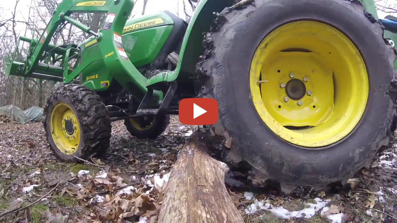 John Deere 3038E Tractor - setting up the mill pile using ...