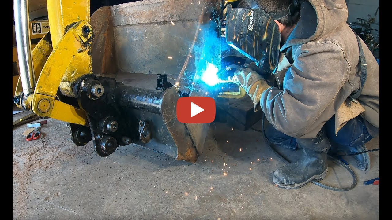 Modifying a grading bucket for an excavator to increase its
